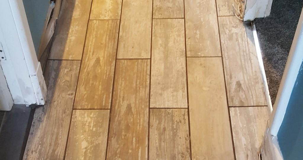 Porcelain wood effect tiles after grouting in Holmes Chapel