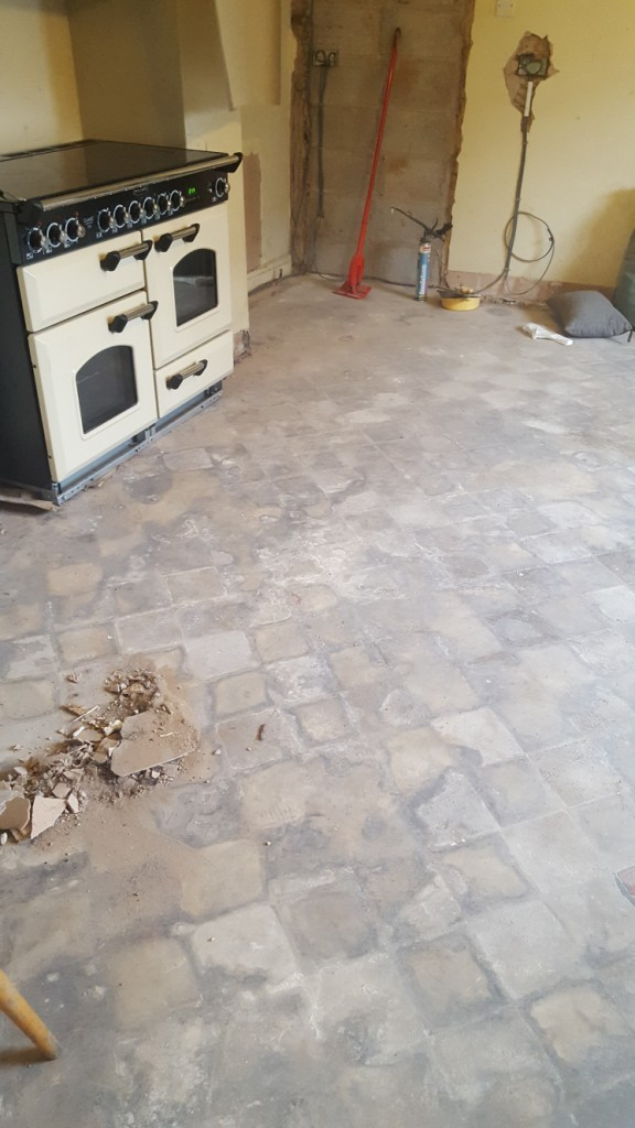 Red and Black Quarry Tiled Kitchen Floor Covered in Screed Before Cleaning in Mobberly