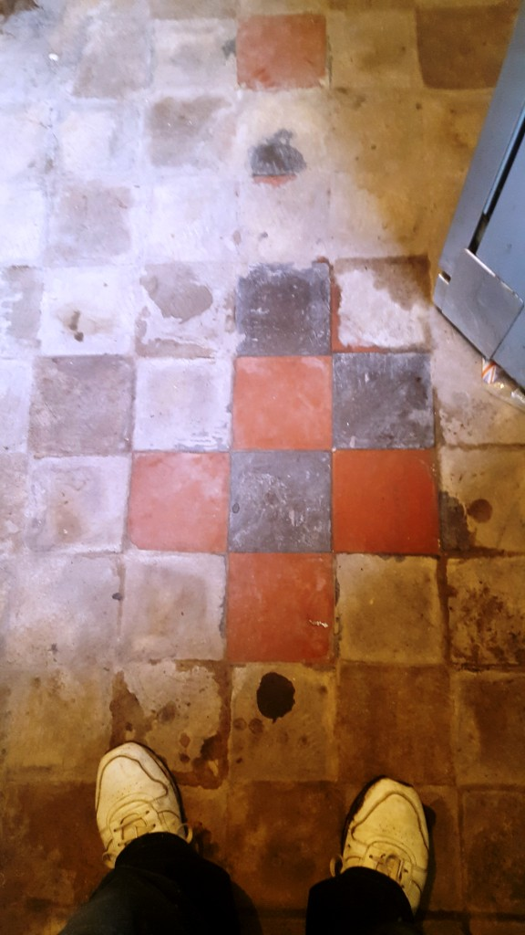 Red and Black Quarry Tiled Kitchen Floor Covered in Screed Test Clean in Mobberly
