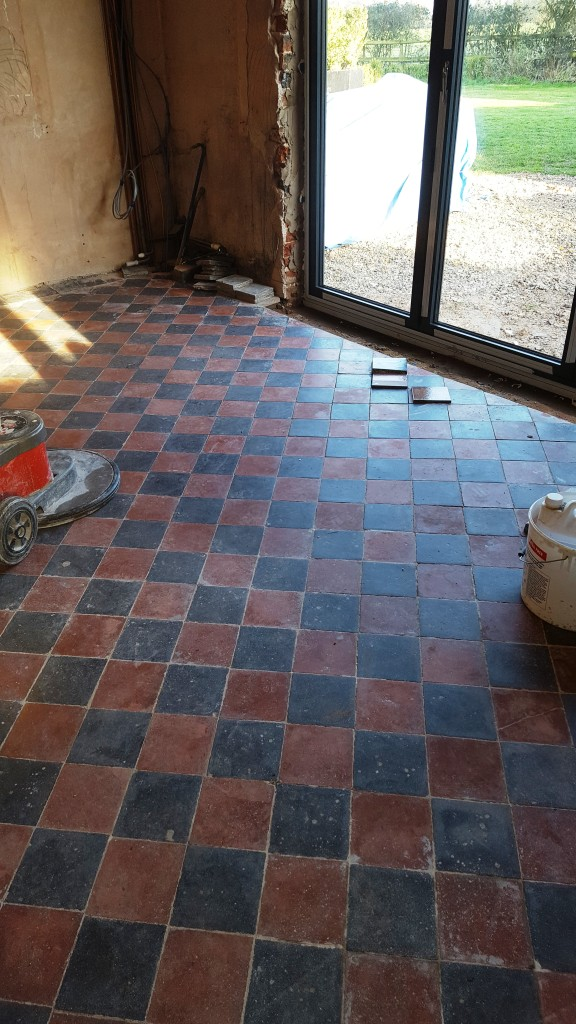 Red and Black Quarry Tiled Kitchen Floor Showing Repaired Tile Section in Mobberly
